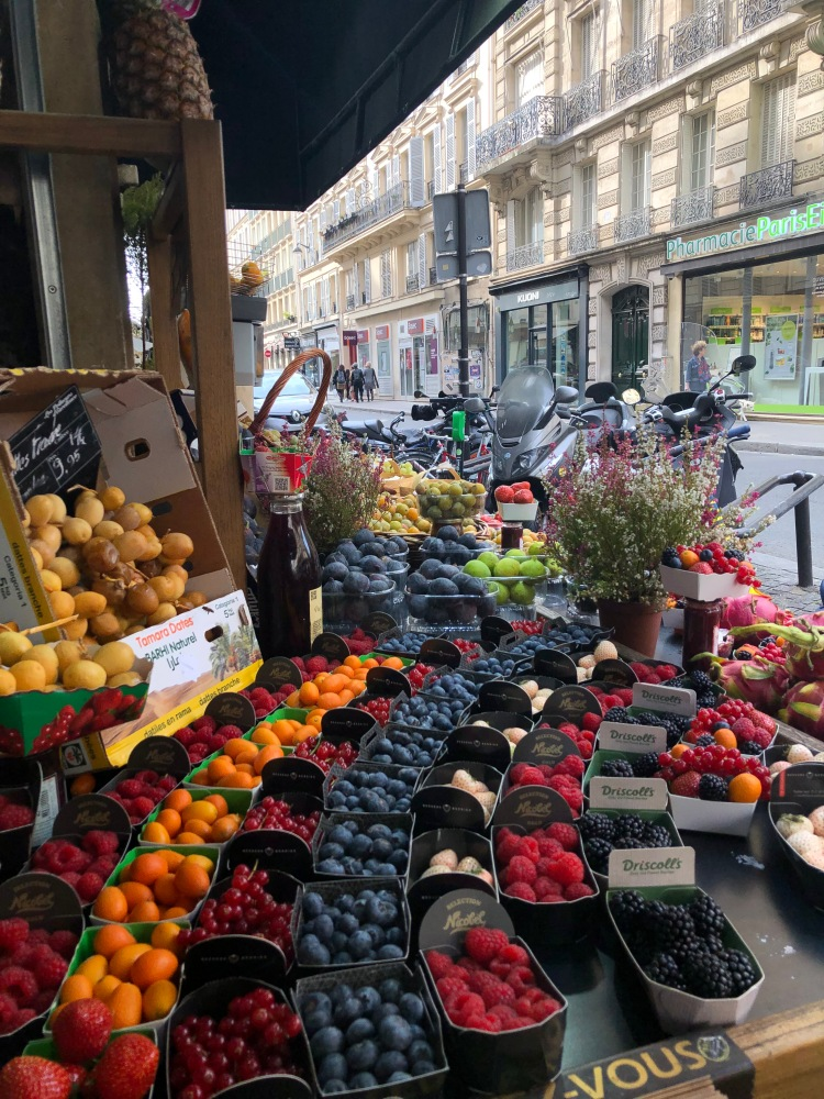 a fruit display at a market on the streets of paris france