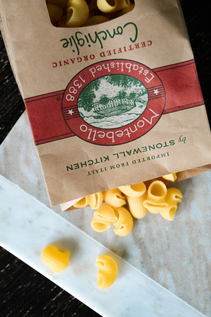 montebello conchoglie pasta falling out of paper bag onto marble cutting board